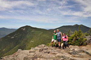 Randy, Tracy, John Swenson, and the Mighty Quinn reach the 48th and final summit in their summertime hiking quest, Mt. Flume.