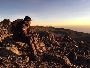 Randy sitting on the summit of Mt. Kilimanjaro at sunrise, thinking about what's next.