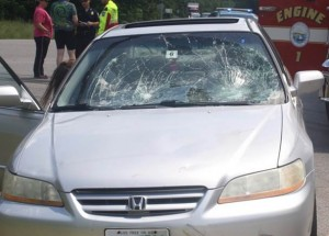 The car with the windshield smashed from the impact of Brent Bell and his friend.