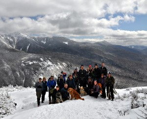 Team of 2020 Vision Quest hikers from the epic accomplishment of the 48th summits in one winter on March 10, 2012. Taken on East Cannon with the Lafayette Ridge in the background on a beautiful winter day!