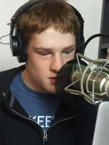 Christopher working at his microphone