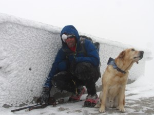 Randy and Quinn on the Summit of Mt. Garfield in the snow.