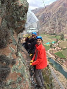 The team climbs up the side of the cliff to the Skylodge.