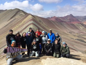 The team with the Rainbow Mountain Range behind them.