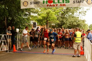 Randy and Andy Bragg at the start of the Hollis Fast 5K on June 14, 2018 with the rest of the race lined up behind them.