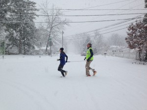 Randy and Christine run in the snow.