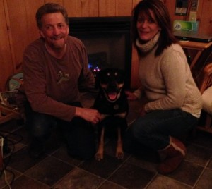 Randy and trainer Chrissy pose with Autumn in front of the fireplace.