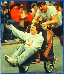 Dick Hoyt pushing his son, Rick, in their first Boston Marathon (1981). Photo courtesy of www.teamhoyt.com.