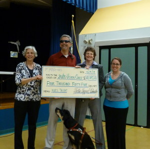 Hollis Elementary School presents 2020 Vision Quest with a generous donation of the proceeds from their talent show.