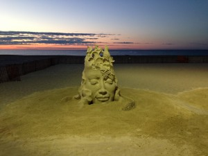 A Whimsical woman's head made from sand