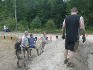 Greg, Randy, Peter, & Christine check out an obstacle