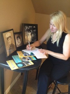 Eileen Doyon surrounded by the keepsakes that inspired the creation of her books.