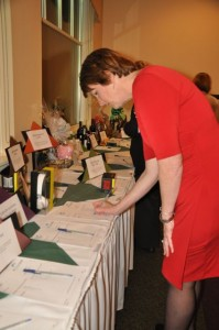 Kim gets into the spirit of the event by making a bid on silent auction items.