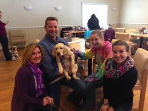 The Ezekiel family poses with Wrangler, who is training with the Today Show staff.