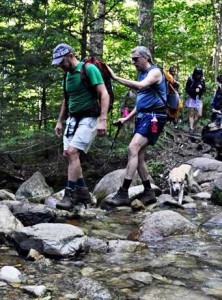 Friend and 2020 Vision Quest secretary John Swenson guides Randy through a water crossing on Mt Liberty.