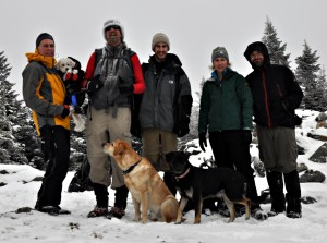 Group standing on the summit in the wintertime.