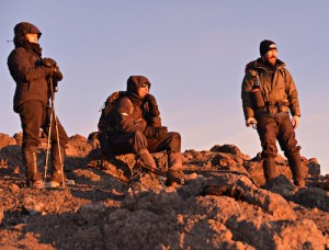 Randy and team watching the sunrise on Mt. Kilimanjaro.
