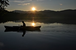Man in a canoe at sunset