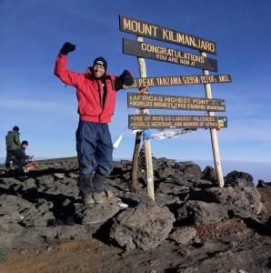 Rob on the summit of Kilimanjaro.