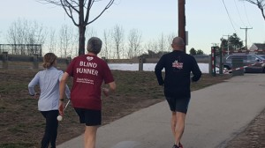 Rebecca and Tom guiding Randy for a run, Marathon training in the early morning, view from the back
