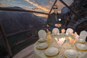 Photo of Randy at a fancy table at Peak Potential superimposed onto a photo of the Skylodge with mountains in the background.