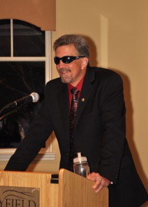 Randy Pierce standing at a podium presenting