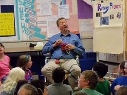 Picture of Randy in a lively interaction with elementary school students in Newmarket, NH