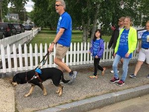 Randy and Autumn walking with young girl and a few other participants at Walk for Sight 2018