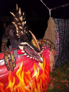 Randy costumed as a dragon.
