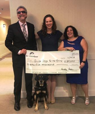 Randy, Tracy, and Nora posed for a picture with the check to from 2020 Vision Quest to Guide Dogs for the Blind