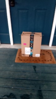 Amazon box sitting right in front of Randy's door.