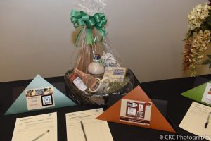 A New Hampshire-themed gift basket with items like maple candy, maple syrup, and strawberry jam