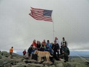 Mt. Moosilauke, group standing on the summit in front of an American flag on Sept. 11, 2011