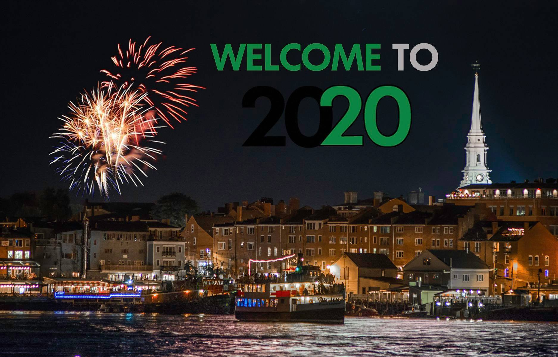 "Fireworks over the Piscataqua River and downtown Portsmouth, NH. Over the city scape, between the fireworks right of frame and the North Church steeple are the words ""Welcome to 2020"" in classic 2020 Vision Quest styling."