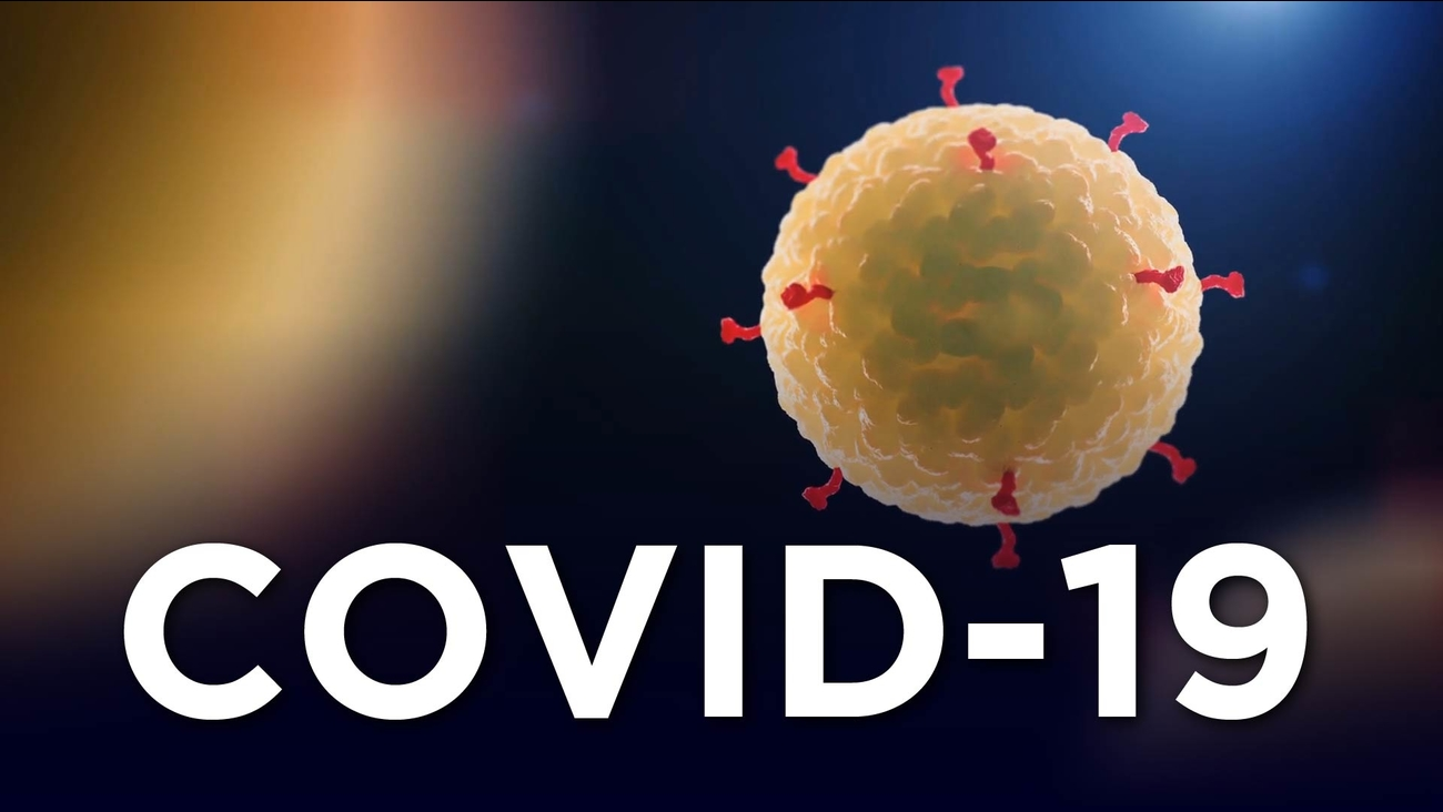 "The word ""COVID-19"" with a simplified rendition of the virus"